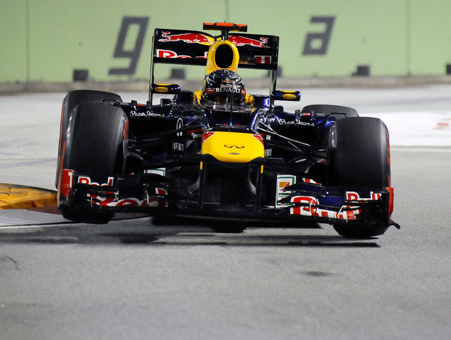 Sebastian Vettel skips over the kerbs at the Singapore Sling