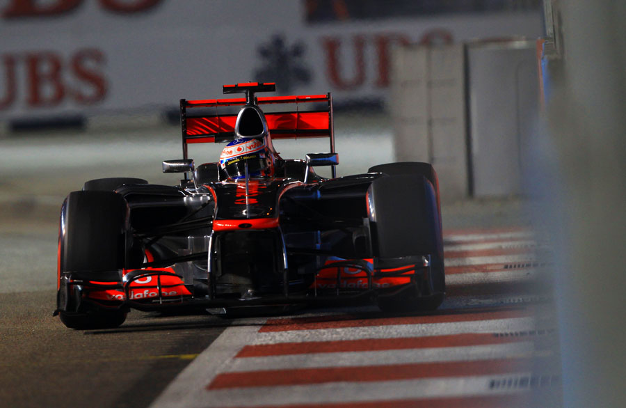Jenson Button runs close to the wall with his DRS wide open