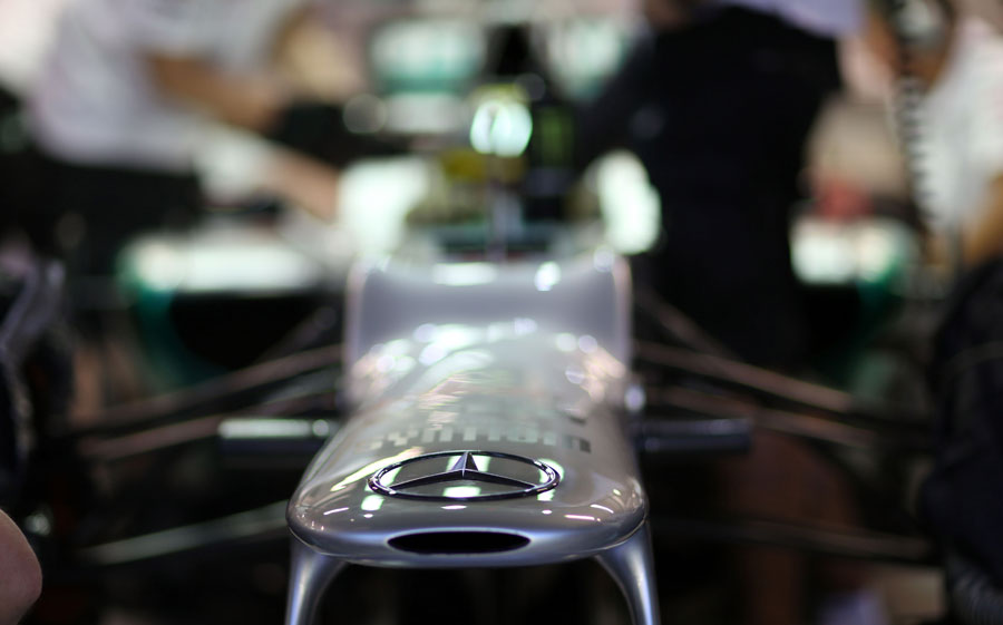 The Mercedes badge on the front of Nico Rosberg's car