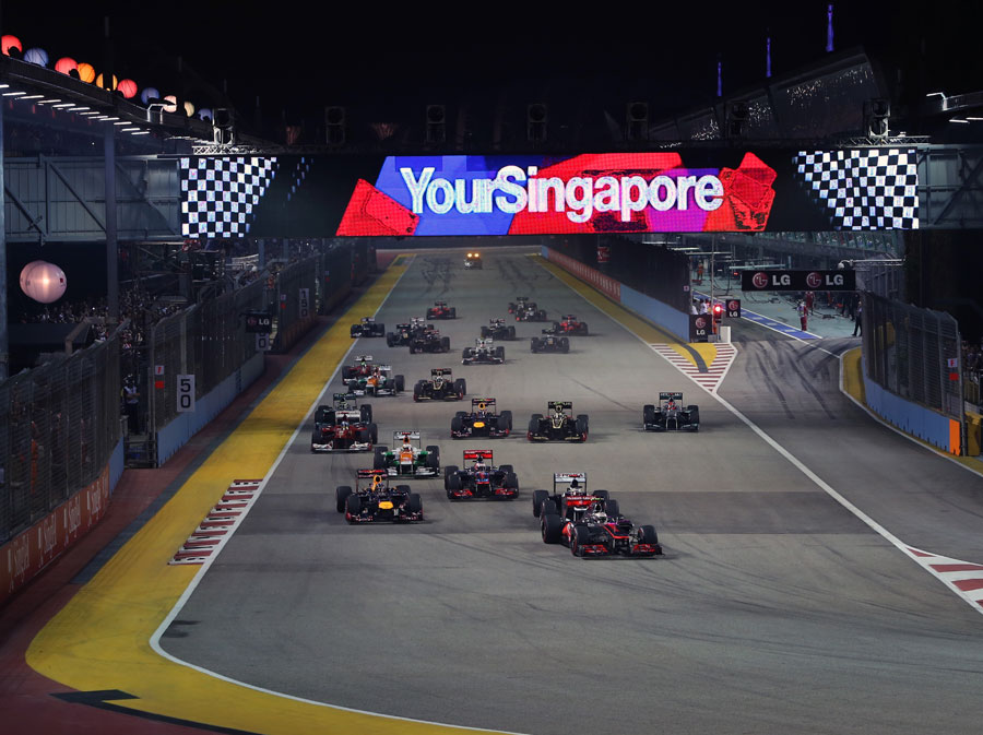 Lewis Hamilton leads the field into turn one at the start of the race