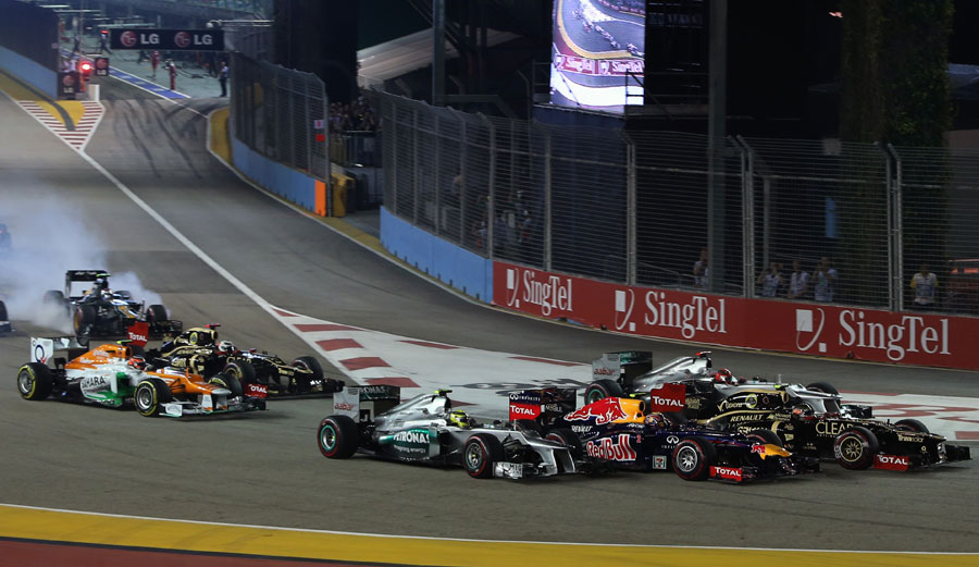 Michael Schumacher, Romain Grosjean, Mark Webber and Nico Rosberg go side-by-side into turn one