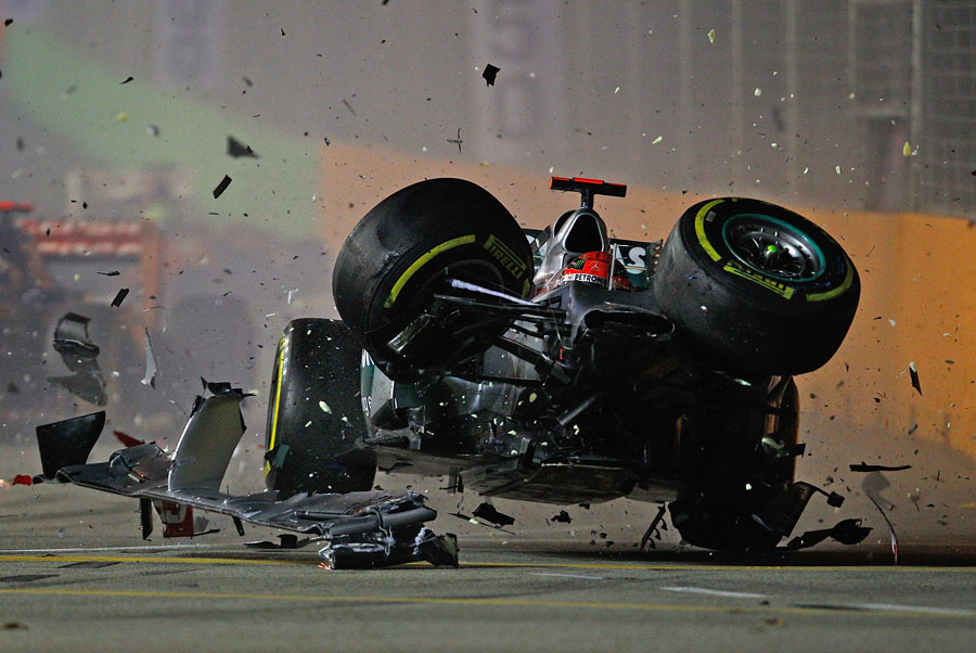 Michael Schumacher crashes out of the race after making contact with Jean-Eric Vergne