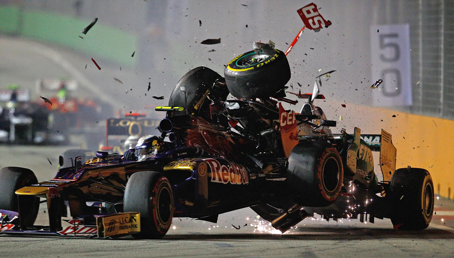 Michael Schumacher crashes into the rear of Jean-Eric Vergne