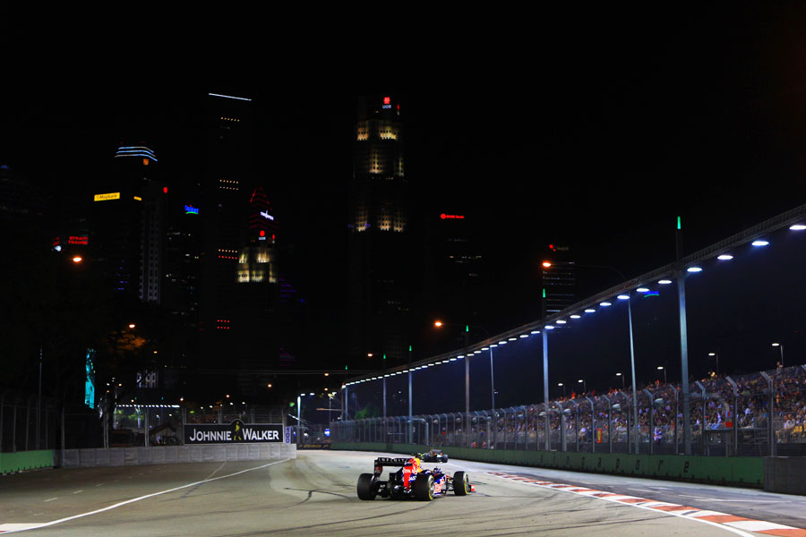 Mark Webber rounds turn seven