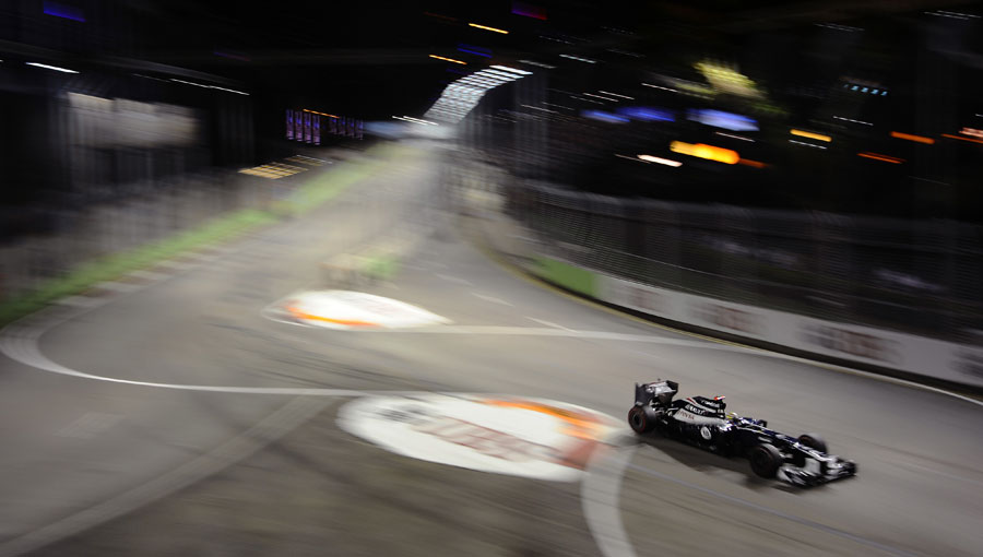 Pastor Maldonado speeds through turn ten