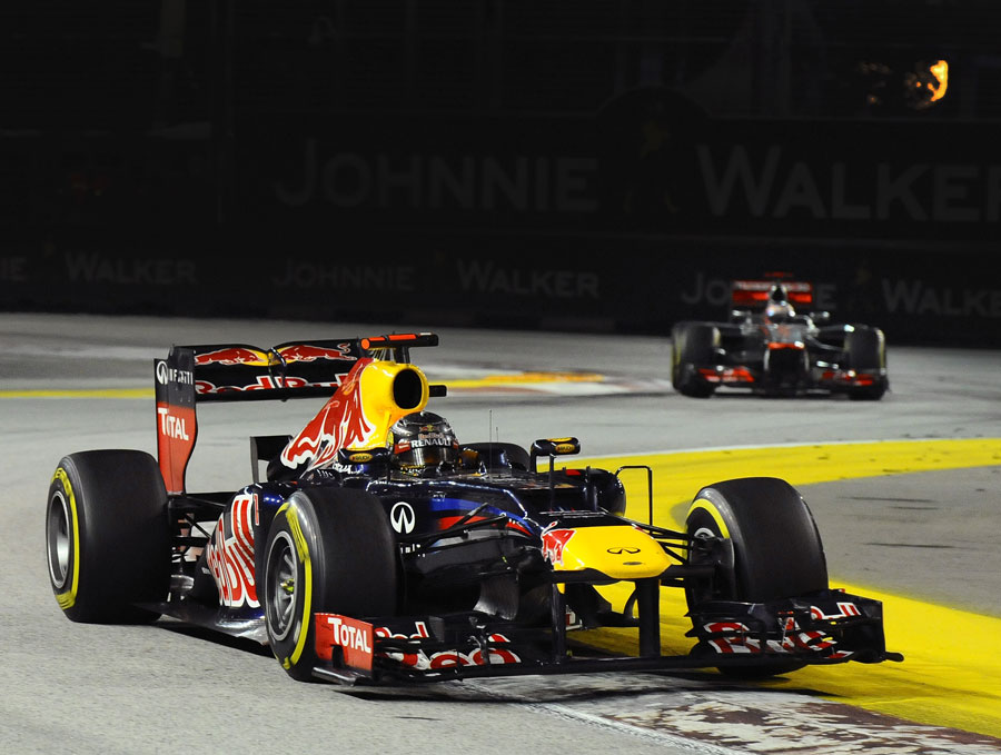 Sebastian Vettel leads Jenson Button during the race
