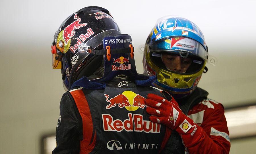 Fernando Alonso congratulates Sebastian Vettel on victory