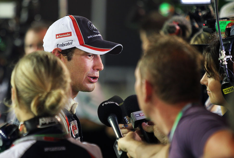 Bruno Senna talks to the media after retiring on the final lap