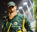 Vitaly Petrov walks through the paddock