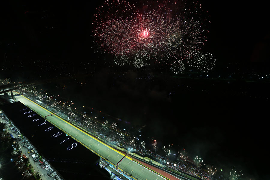 Fireworks explode over the circuit after the race
