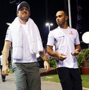 Lewis Hamilton and Nico Rosberg walk through the paddock