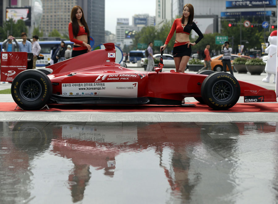 Models pose in downtown Seoul to promote this year's Korean Grand Prix