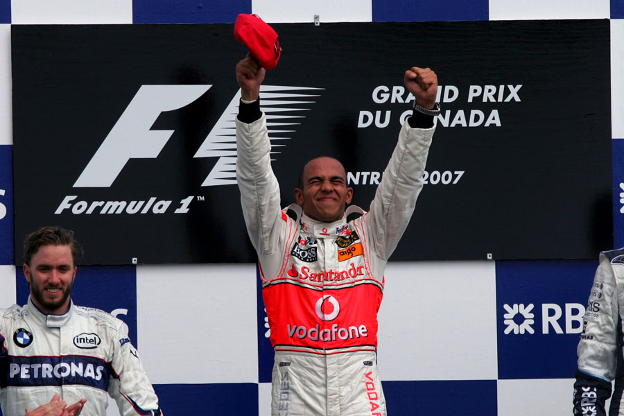 Lewis Hamilton celebrates his maiden grand prix victory