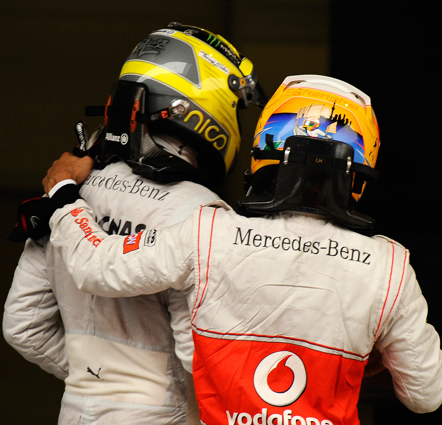 Lewis Hamilton celebrates with race winner Nico Rosberg
