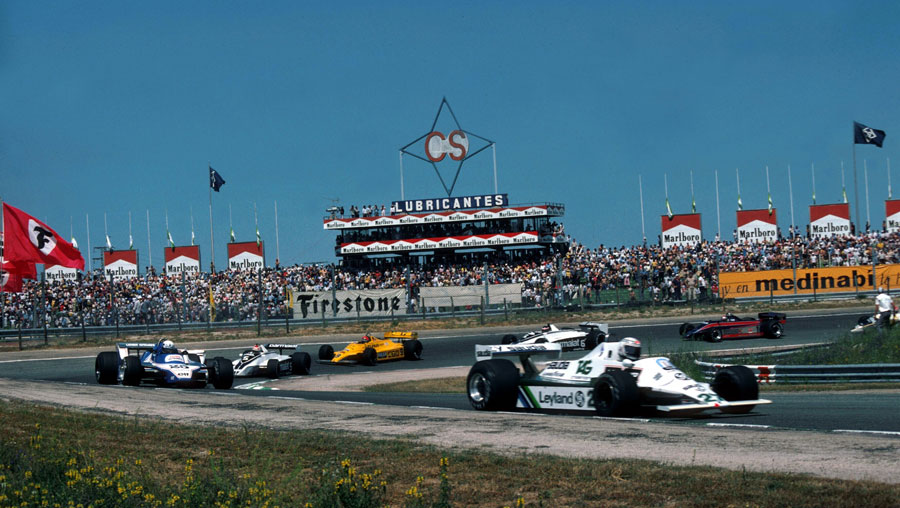 Alan Jones leads the field on the opening lap