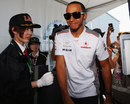 Lewis Hamilton arrives in the paddock