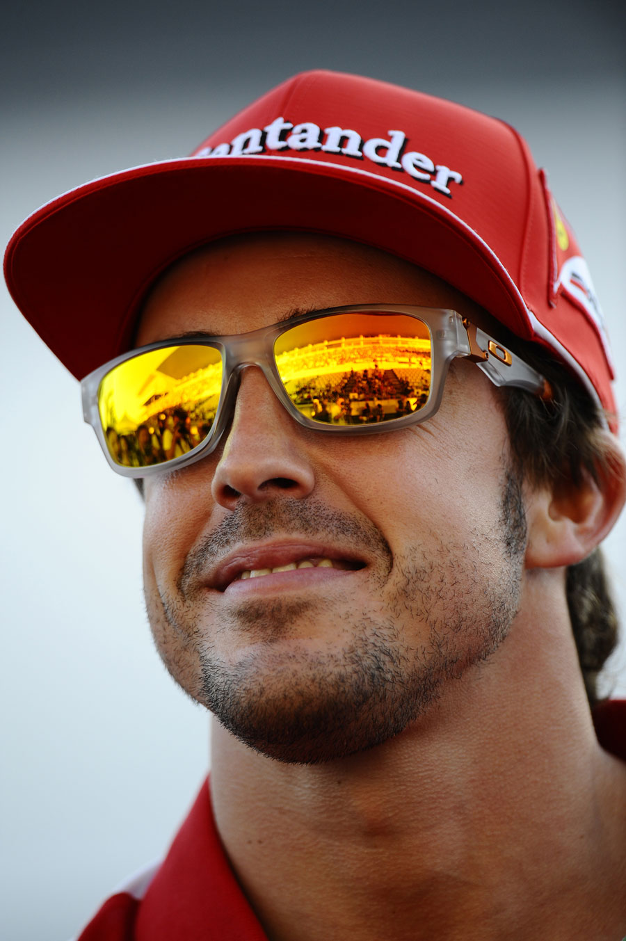 Fernando Alonso smiles at fans in the pit lane