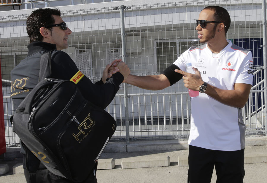 Lewis Hamilton greets Pedro de la Rosa in the paddock on Friday