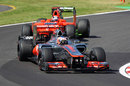 Jenson Button leads Timo Glock on track