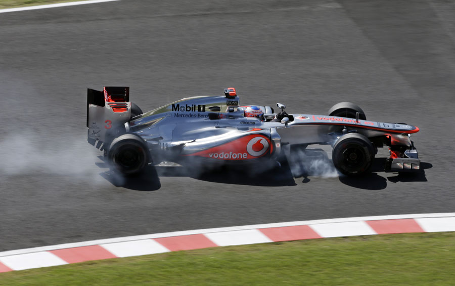Jenson Button locks up at Degner Two