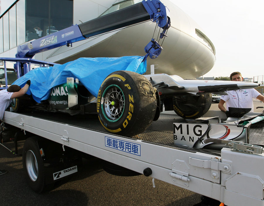 Michael Schumacher's Mercedes is returned to the pits