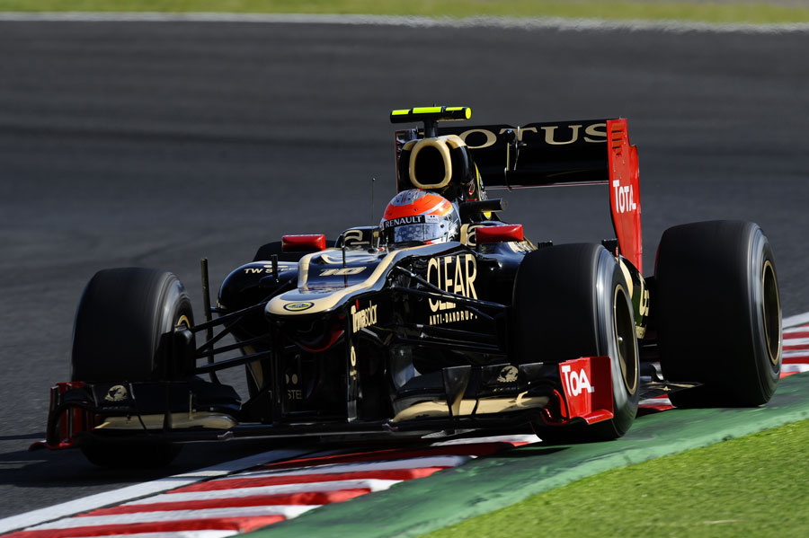 Romain Grosjean on track in the Lotus