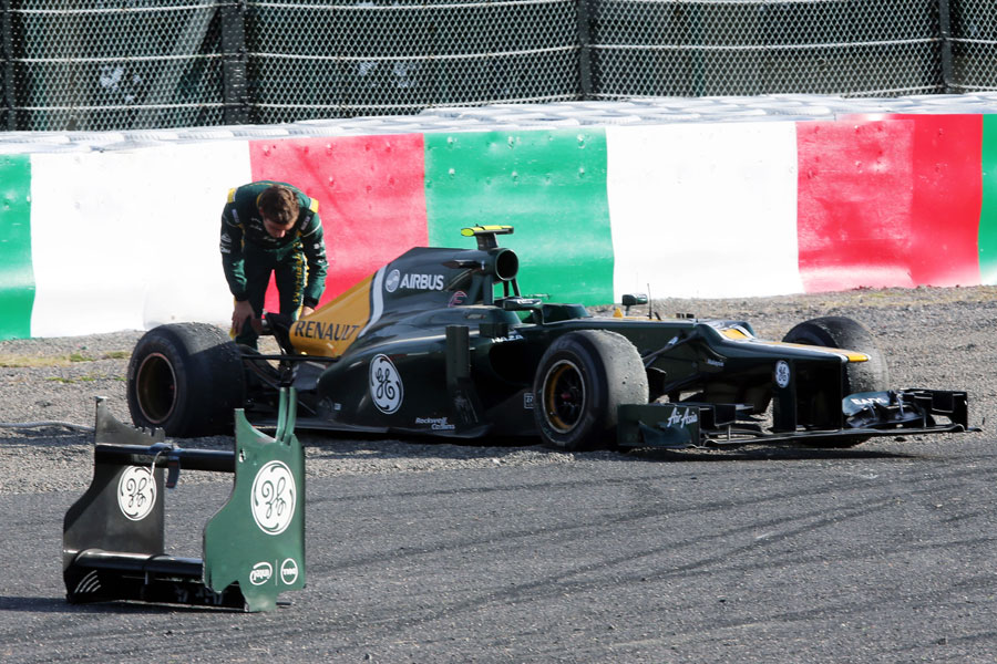 Vitaly Petrov inspects his Caterham after the rear wing fell off at the end of FP2