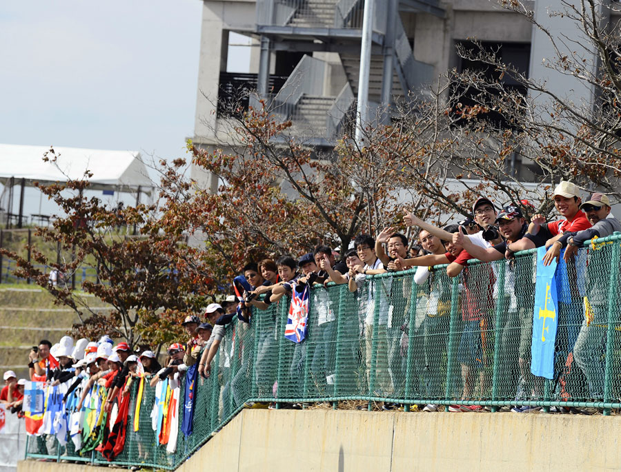 Fans wait outside the circuit on Saturday morning