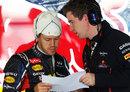 Sebastian Vettel studies data in the Red Bull garage