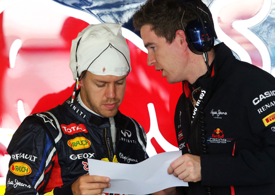 Sebastian Vettel studies data in the Red Bull garage