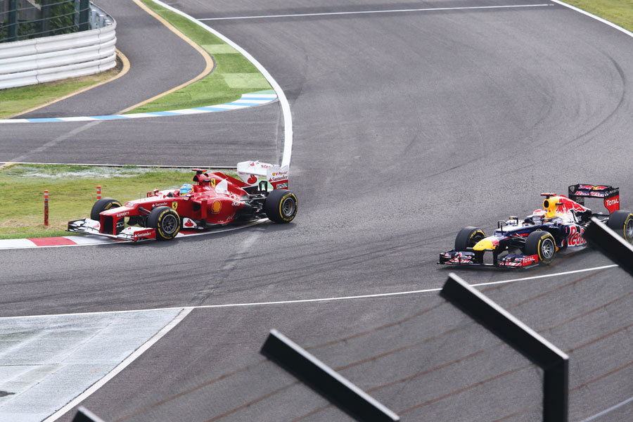 Fernando Alonso passes Sebastian Vettel through the final chicane