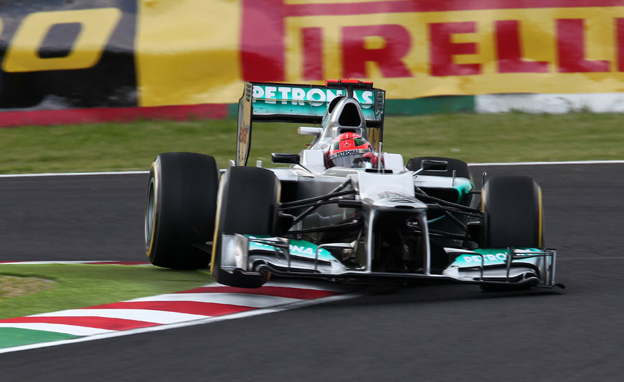 Michael Schumacher jumps his Mercedes over the kerbs