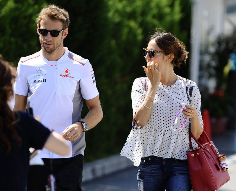 Jenson Button and Jessica Michibata arrive in the paddock