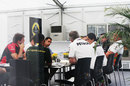 A meeting of team principals in the Lotus motorhome