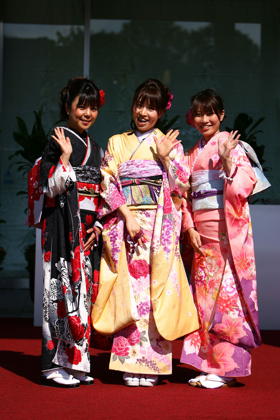 Girls in traditional dress in the paddock