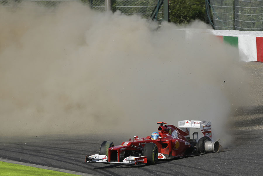 Fernando Alonso spins to a halt at the first corner