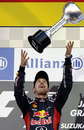 Sebastian Vettel celebrates with his trophy on the podium