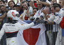 Kamui Kobayashi celebrates his maiden podium in parc ferme