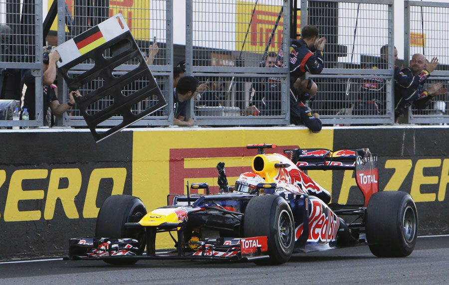 Sebastian Vettel celebrates as he crosses the line