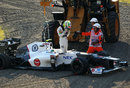 Sergio Perez climbs out of his Sauber after spinning off at the haripin