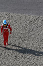 Fernando Alonso walks away from his car after spinning out at turn one