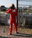 Fernando Alonso watches on from the side of the track after spinning out at turn one