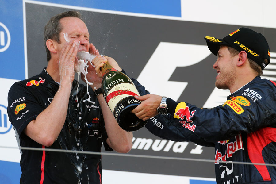 Sebastian Vettel sprays champagne over head of car engineering Paul Monaghan