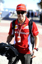Fernando Alonso arrives in the paddock on Thursday