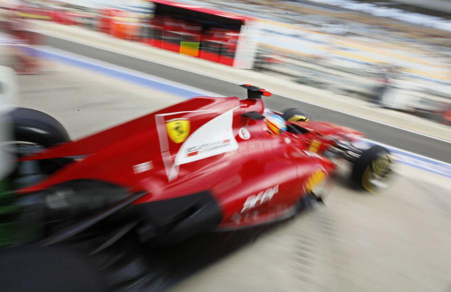 Fernando Alonso leaves the Ferrari garage