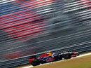 Sebastian Vettel blasts past empty grandstands during Friday practice