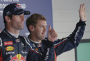 Mark Webber and Sebastian Vettel in parc ferme after qualifying
