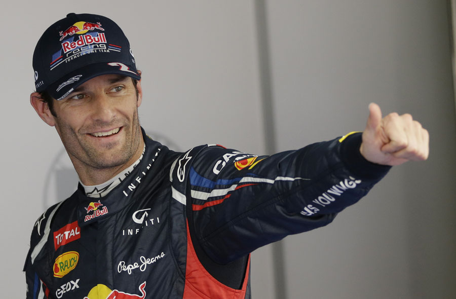 Mark Webber celebrates in parc ferme after qualifying
