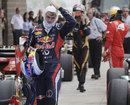 Sebastian Vettel takes his balaclava off in parc ferme