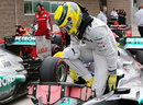 Nico Rosberg climbs out of his car after qualifying